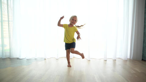 Preschool sister dancing movement on bright window light background Live Action