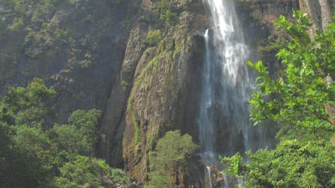 pictorial large waterfall surrounded by high rocky cliffs Live Action
