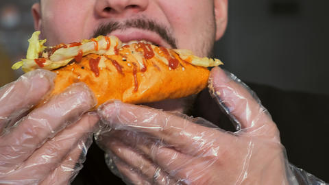 eating a hot dog in gloves Live Action