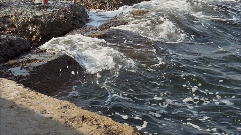 Sea waves crash on the shore, view from the pier on the Black Sea 실사 촬영