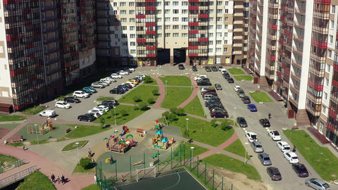 safe playground near comfortable multistory buildings aerial Live Action