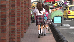 School Girls Running On Sidewalk Footage