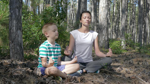 Mother And Son Doing Meditation Footage
