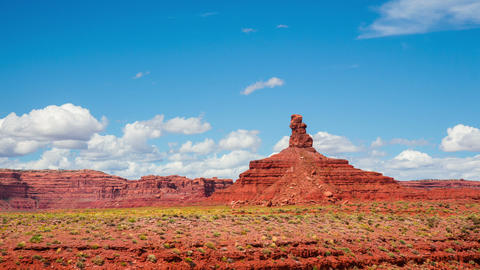 Time Lapse - Cloudscape Moving Over Butte at Monument Valley, Panning View Live Action