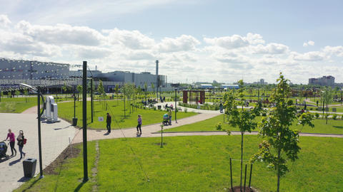 city garden with walking people on sunny day aerial view Live Action
