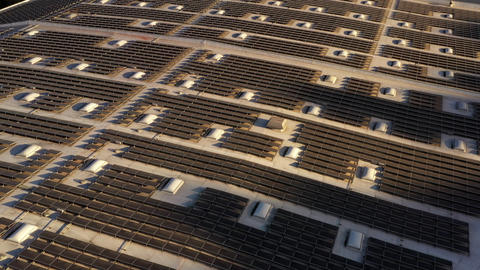 Aerial shot of solar panels covers the roof of a large building 실사 촬영