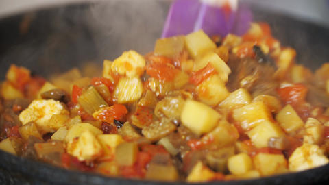 Preparing vegetables meal in cooking pan Live Action