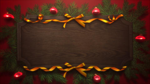 Animated close up red balls and Christmas green tree branches on wood background 애니메이션