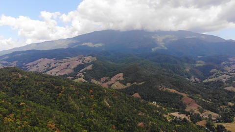 Aerial view scenic landscape of tropical forest and mountain against a blue sky, Drone shot Live Action