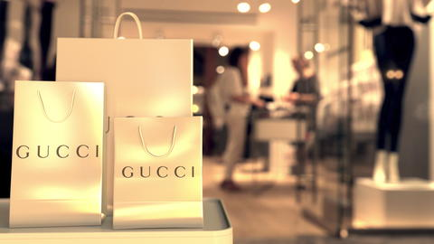 Shopping bags with Gucci logo. Editorial shopping related 3D rendering Photo