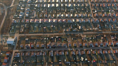 Aerial view cottage village with same red brick houses roofs shine at sunset. Modern cottage village Live Action