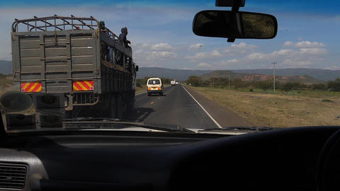 Road and Traffic on the Road from Nairobi to Tsavo Park, Kenya, Slow Motion Live Action