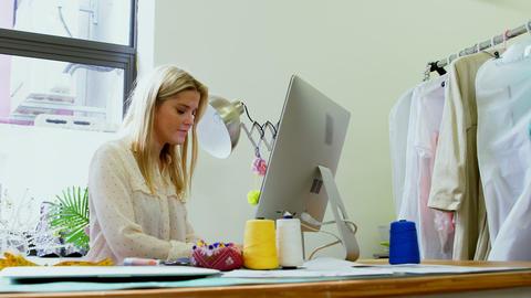 Fashion designer using desktop pc at desk 4k Live Action