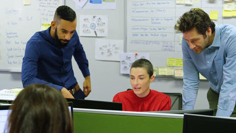 Executives discussing on desktop pc at desk 4k Live Action
