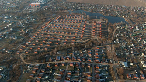 Aerial landscape luxury cottage village in countryside. Modern brick houses in countryside village Live Action