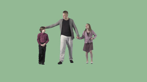 Young man is walking with son and daughter at the camera. Transparent background Live Action