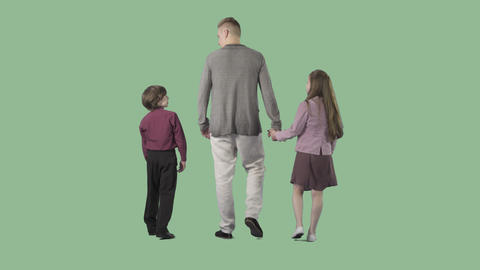 Young father is walking with children from the camera. Transparent background Footage
