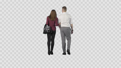 Young couple (male and girl) are slowly strolling from the camera. Alpha channel Footage