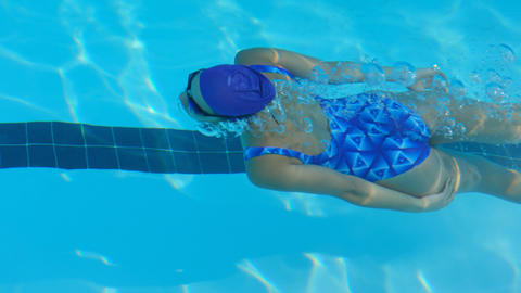 Young female swimmer swimming inside pool 4k Live Action