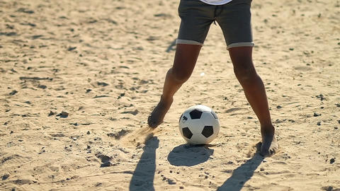 Boy alone playing with the football in the ground 4k Live Action