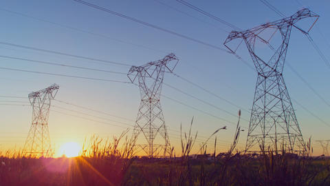 Time lapsed of electricity pylon on a field during sunset 4k Live Action
