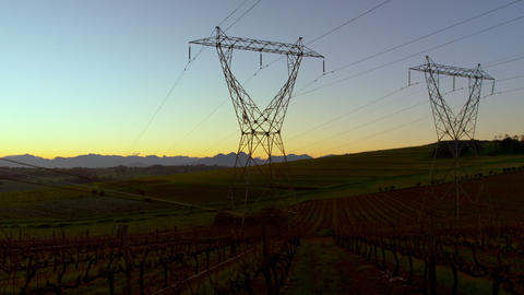 Time lapsed of electricity pylon on a field at dawn 4k Live Action