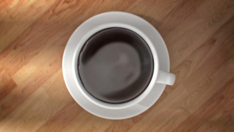 Super slow motion drops of coffee are falling into Cup in 4K Animation