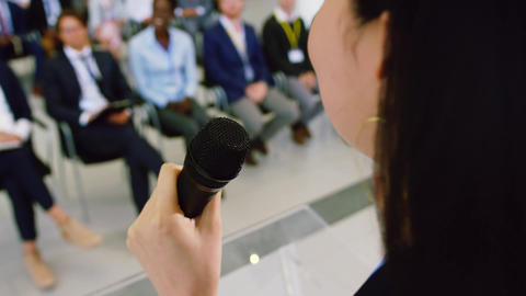 Female speaker speaks in a business seminar 4k Live Action