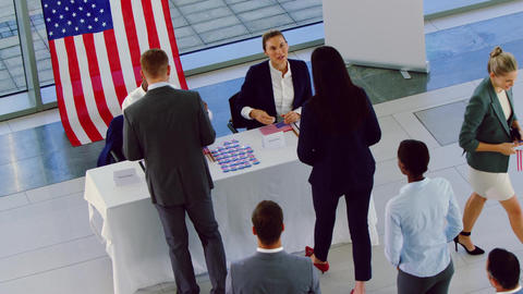 Business people checking in at political campaign registration table 4k Live Action