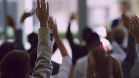 Business professionals raising their hands in a business seminar 4k Live Action