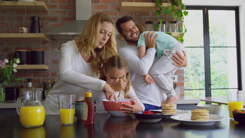 Family preparing food on worktop in kitchen at comfortable home 4k Live Action