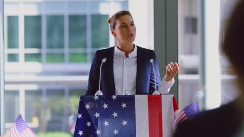 Female speaker speaks in a political campaign seminar at modern office 4k Live Action
