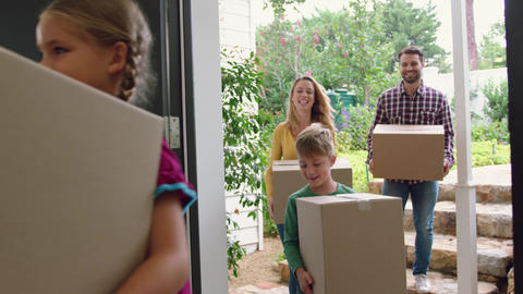 Family with cardboard, boxes entering in a comfortable home 4k Live Action