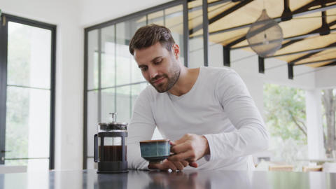 Man drinking coffee at dining table in a comfortable home 4k Live Action