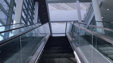 Low angle view of Modern escalator in a office lobby 4k Live Action