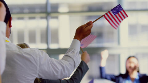 Business people waving american flag in a seminar 4k at political campaign Live Action