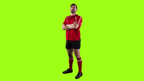 Professional rugby player standing with crossed arms Live Action