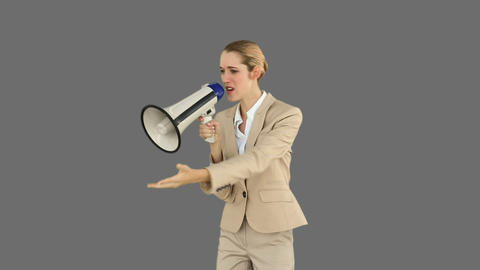 Bossy businesswoman shouting through megaphone Live Action