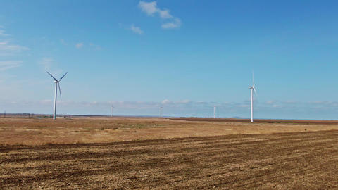 Aerial view of wind turbine landscape. Wind farm eco field on beautiful sunny Live Action