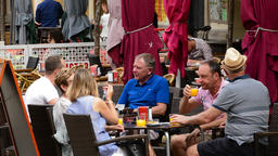 People sitting on the terrace of a bar on a promenade Footage