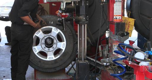 Mechanic repairs flat tire balance wheel DCI 4K 295 Footage