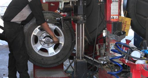 Repair automobile mechanic shop repair tire DCI 4K 295 Footage