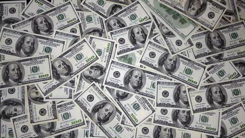 One Hundred Dollar Bills Falling Through Air Footage