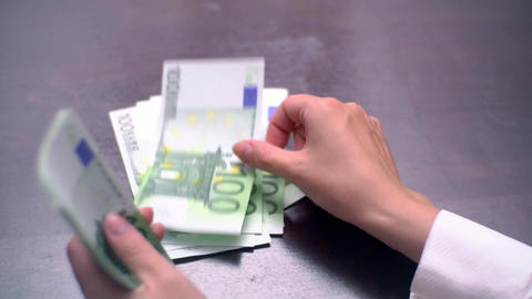 View of a Woman Counting Many Euro 100 Bills Footage