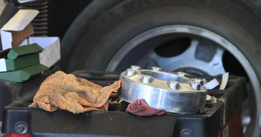 Automobile mechanic works balance tire DCI 4K 294 Footage
