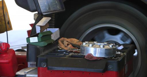 Balance tire Auto mechanic repair shop DCI 4K Footage