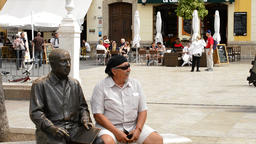 Sculpture of painter Pablo Ruiz Picasso with tourist Footage