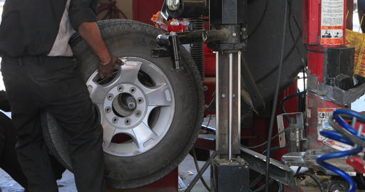 Wheel balance automobile repair shop fast motion DCI 4K 296 Footage