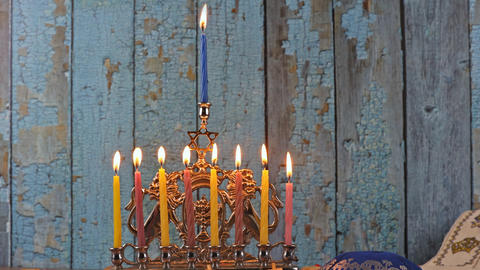 Last eighth day of the Jewish holiday Hanukkah. Nine Hanukkah candles are Live Action