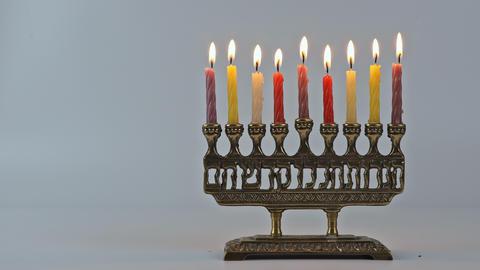 Jewish Menorah lighting Hanukkah candles burning Live Action